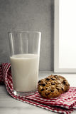 Glass of milk with chocolate cookie Stock Photos