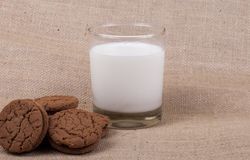 Glass of milk with chocolate fudge cookies. A glass of milk with chocolate fudge cookies Stock Photography