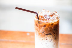 Glass of milk coffee with ice cubes Royalty Free Stock Photography