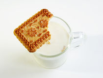 A glass of milk and cookie Stock Photography