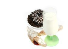 Glass of milk and cookies Stock Images