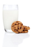 Glass of milk and cookies. On a white background Stock Images