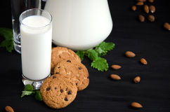 Glass of milk cookies almonds mint Royalty Free Stock Photography