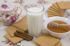 Glass of milk and cookies on a beautiful cloths Stock Photo