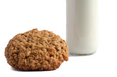 Glass of milk and cookies isolated on white. Glass of milk and delicious cookies isolated on white stock photography