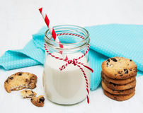 Glass of milk and cookies. On a old white wooden background Royalty Free Stock Photo