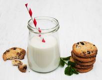 Glass of milk and cookies. On a old white wooden background Stock Images
