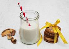 Glass of milk and cookies. On a old white wooden background Royalty Free Stock Images
