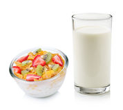 Glass of milk and corn flakes with fruit Royalty Free Stock Photo