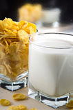 Glass of milk and cornflakes for cooking. Closeup Stock Photo