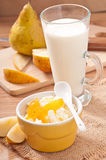 Glass of milk and cottage cheese in bowl Royalty Free Stock Images