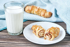 Glass with milk and croissant Royalty Free Stock Photos