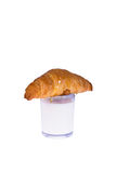 Glass of milk and croissant Stock Images
