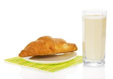 Glass of milk and croissant on a napkin Royalty Free Stock Photography