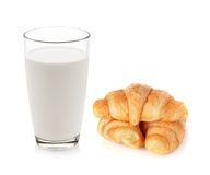 Glass of milk and croissants. Isolated on white Royalty Free Stock Photo