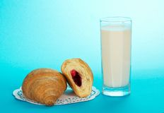 Glass with milk and croissants, a napkin Royalty Free Stock Photos