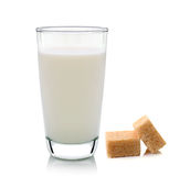 Glass of milk and cubes of cane sugar Stock Photo
