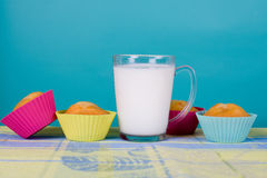 Glass of milk and cupcakes Royalty Free Stock Images