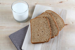 Glass of milk and dark bread Royalty Free Stock Photography