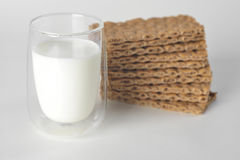 Glass of milk and dry bread with seeds Royalty Free Stock Image