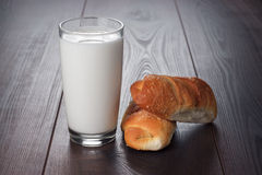 Glass of milk and fresh buns Stock Image