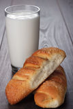 Glass of milk and fresh buns on the table Royalty Free Stock Photo