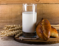 Glass with milk and fresh pies Stock Image