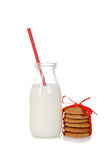 Glass of milk with ginger cookies Stock Images