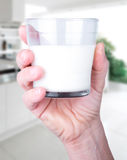 Glass of milk in hand Royalty Free Stock Photo