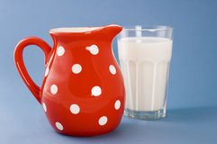 Glass of milk and jug Royalty Free Stock Photo