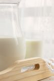 Glass of milk and a jug Royalty Free Stock Photography