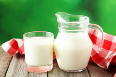 Glass of milk and jug Stock Images