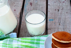 Glass of milk and a jug of milk Stock Images