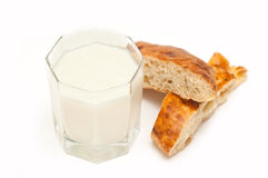 Glass of milk or kefir with baton Stock Photos