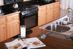 Glass of milk on kitchen counter Royalty Free Stock Photography