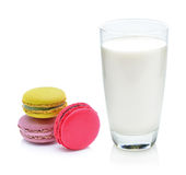 Glass of milk and macaroon Stock Photos