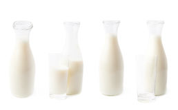 Glass of milk next to bottle isolated royalty free stock photography