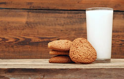 Glass of milk and oat cookies Stock Photography