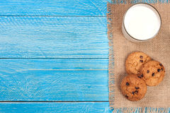 Glass of milk with oatmeal cookies on a blue wooden background with copy space for your text. Top view Royalty Free Stock Photo