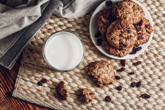 Glass of Milk and Oatmeal Cookies on White Plate Royalty Free Stock Images