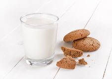 Glass of milk and oatmeal cookies Stock Photos