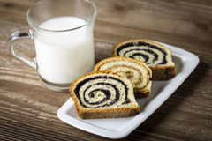 Glass of milk with poppy seed cakes Stock Photography