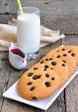 Glass of milk, raspberry jam and handmade cookies Royalty Free Stock Photography