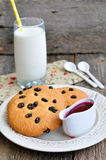 Glass of milk, raspberry jam and handmade cookies Stock Image