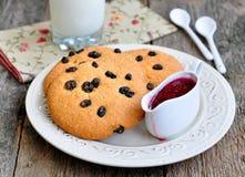 Glass of milk, raspberry jam and handmade cookies Stock Photo