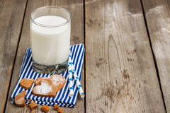 Glass of milk on a rustic wooden table Royalty Free Stock Image