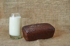 A glass of milk with rye bread Royalty Free Stock Images