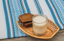 Glass of milk and rye bread Royalty Free Stock Photo
