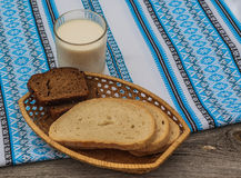 Glass of milk and rye bread Stock Photos