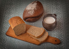 Glass of milk and rye bread Stock Image